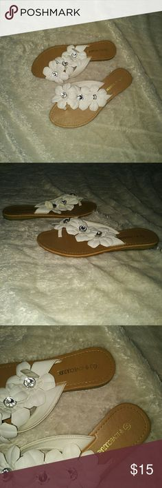 Love Culture white flower flip flop Wore these once for a luau party, good condition no tears, size 7 1/2. The flowers are like a faux leather with silver stone in the middle. Smoke free home! Love Culture Shoes Sandals