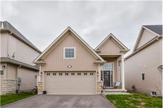 Bright Living Rm with Hardwood Floors, Gas Fireplace & 2 Pc. Hardwood Floors, Flooring, Home List, Gas Fireplace, Bungalow, The Neighbourhood, Garage Doors, Shed, Outdoor Structures