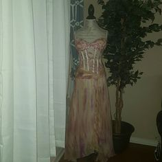 Stunning pink and green corset gown Stunning pink and green corset gown.  In perfect condition has only been worn once! Corset is sheet but covered with beautiful beading! 70%silk 30% polyester. botique Dresses