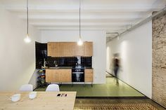 Beautiful Floor Tiles in This Old Barcelona Apartment Remodeled by RÄS