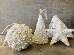 "Ball, Tree and Star Pearl Christmas Ornaments Beach Ocean Chic Pearl Ball Star Pearl Christmas Ornament Tree Pearl Christmas Ornament Elegant pearl decorated ornaments. Perfect on any tree. Measurements: Tree: 4"" Star: 3.5"" Ball: 3"""