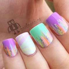 Abstract and baby colored glitter nail art design with tiny glitter accents from the cuticle to the middle of the nails.