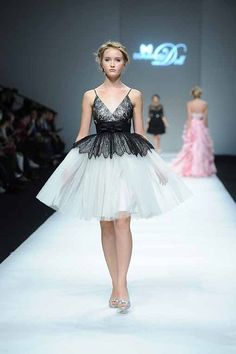 Shanghai Fashion Week started yesterday. One of the highlights was the Doll collection by Dorian Ho. She was inspired by the French Spirit and played with reds, corals and contrasting shades of black and lilly white. Her Parisian vision includes ruffles, mermaid gowns with Swarovski Elements and taffeta ball-gowns with floral appliques.  Posted by Diane Pernet, A Shaded View On Fashion