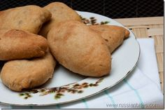 pechionii pirojki - baked Russian hand pies with meat and cheese