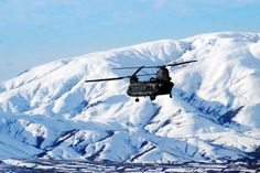 A U.S. Army CH-47 Chinook helicopter crew conducting an air assault mission passes the snow-capped mountains of Paktya province, Afghanistan, Nov. 27, 2013. The crew is assigned to the 3rd Battalion General Support, 10th Combat Aviation Brigade, Task Force Phoenix, deployed from the Texas and Oklahoma National Guards.