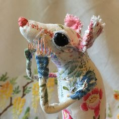 Nigella is a freestanding hand stitched textile Sculpture. Created using vintage hand embroidered placemats and antique floral linen. Her eyes are...