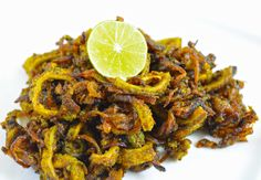 Tangy masala karela is a healthy and a delicious preparation with flavours of amchur and other spices. The addition of onion and jaggery reduces the acridity and adds to the taste.