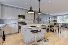 Traditional Kitchen with Dura Supreme Flat Panel Cabinet Doors, Breakfast nook, Undermount sink, Breakfast bar, Flush