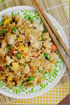 Chicken Fried Rice - Easy and Filling Family Meal.2 cups prepared rice (I used long grain brown rice) 1 chicken breast, cut into bite-sized pieces and seasoned with salt and pepper (could use leftover cooked chicken) 1/2 cup frozen mixed vegetables 2 green onions, chopped 1 clove garlic, minced 1 egg 3 teaspoons sesame or wok oil, divided 2 Tablespoons soy sauce-USE FRESH VEGGIES!
