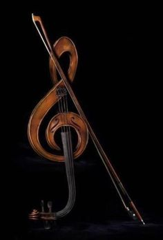 As far as I can tell, this is a real treble clef-shaped violin.  The woodwork is beautiful.