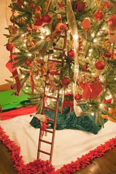 elves on a ladder against a Christmas tree.. I want to do this except with snowmen on the ladder