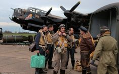 The 'crew' dressed up in the old -fashioned uniforms and sat inside 'Just Jane', one of only thee Lancasters left in the world capable of flying