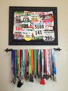 Race bib and medal display. Use a curtain rod for the medals and a framed cork board for the bibs. #running