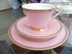 Doulton deco: unnamed tea trio by Herbert Bettley, H4383, BB3445, Rd 776716, c1935 (8, pattern). Pink colourway - gold gilt braid edging on pink ground with gold gilt highlights and trim. Variant of unnamed patterns (H4380, H4381).