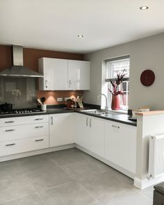 New build white gloss kitchen with terracotta wall and black worktops. Gloss Kitchen Cabinets, White Kitchen Cupboards, White Gloss Kitchen, Kitchen Worktop, Kitchen Units, Kitchen Cabinet Design, Modern Kitchen Design, Kitchen Tiles, Kitchen Flooring