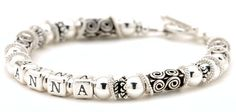 Sterling Silver Mothers Bracelet for mom who loves ornate sterling silver!  Designed with handcrafted Bali silver beads and lots of floating loose rings, this name bracelet is truly unique.  The name can be arranged in the center of the strand or off center and the bracelet can be made up to 4 strands.  All bracelets come with a charm.