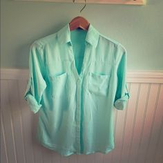 EXPRESS portofino shirt Lovely portofino shirt in an aqua color! Looks amazing with white pants or black. Roll the sleeves up (as shown) or roll them down. Express Tops