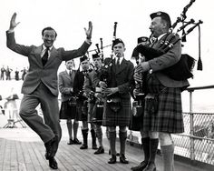 British actor David Niven doing a traditional Scottish jig.