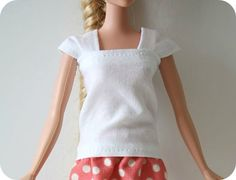 barbie cap sleeve shirt,one 6 1/2″ x 3″ piece of fabric two pieces of fabric 3″x1 1/2″, one side cut on a slight curve