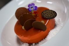 Chef Nicolas Jardin:Plénitude offers the powerful sensations of Chocolate Sable, Pineapple Roties Facon Tatin, Cremeux Milk Chocolate, Glaze Milk Chocolat and Caramel. Two-in-one: a sweet delicacy and a cake.