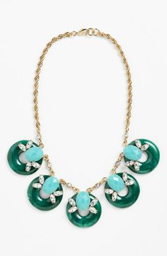 A green and blue statement necklace is perfect for spring!