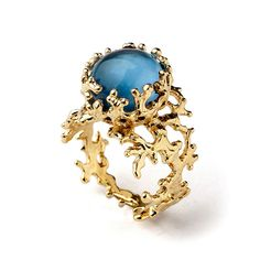 Gold coral like ring with Blue stone https://www.etsy.com/listing/208491241/coral-london-blue-topaz-ring-gold-blue