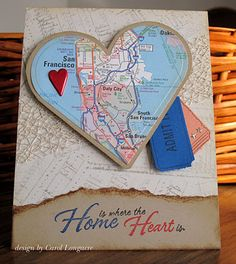 handmade card ... sentiment: Home is where the Heart is. ... die cut map into a heart shape and adhere a bright heart ... great idea for upcycling maps ....
