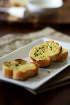 Home-made garlic bread by Gourmand Recipes  Garlic Bread Recipe INGREDIENTS: 1 French baguette3 tablespoons butter, softened2 cloves garlic (small), minced1 teaspoon chopped parsley METHOD: 1. Combine the butter, garlic and parsley in a small bowl and mix well.2. Slice the baguette into 1/2-inch thick slices.3. Spread a thick layer of the garlic butter on the bread slices.4. Place the bread slices on a baking tray in a single layer.5. Grill under a broiler until the butter has melted and the…