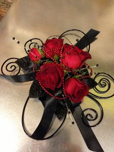 The Phantoms Corsage -  Stunning and Elegant www.jldesignsfloral.com  prom and dance corsages