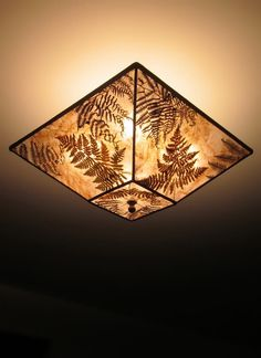 This light mica square with filled with a mix of natural fern fronds, is great in a garden-focused room! They fill the shade with their graceful curving and bring to mind the shaded creek beds, light filtering through the surrounding forest… Ceiling Shades, Ceiling Light Fixtures, Ceiling Lamp, Ceiling Lights, Vintage Pendant Lighting, Rustic Lighting, Custom Lamp Shades, Ferns, Bulb
