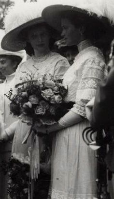 Tatiana & Olga at some ceremony. They are wearing identical clothing, so therefore it may be a wedding...