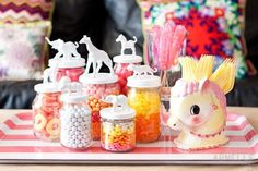 Top display jars with animal figurines you've sprayed painted and glued down.