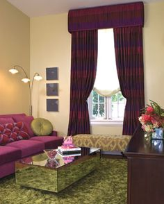 "A Lady's Office by Kathy Corbet who believes that ""every woman should have a space in the house that's entirely hers."" Working with a color scheme of magenta, plum and ultraviolet cooled down by a gentle celery green, Corbet created a lady's office that has enough verve to be interesting while still providing a calm space. The window treatment is like a ball gown-striped silk by Donghia, richly gathered and tucked under a shirred cornice with a sheer, relaxed  shade by Duralee underneath. Cool Stuff, Window Treatments, Decor, Cornice, Color Schemes, Redecorating, House, Home Decor, Duralee"