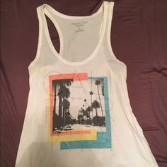 American Eagle tank top Cute tank top! A few minor stains... Not noticeable when worn! American Eagle Outfitters Tops Tank Tops