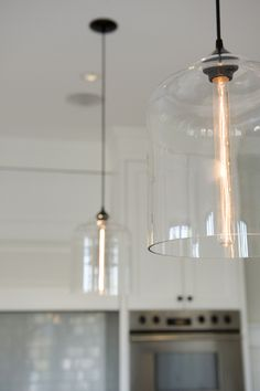 Bell Jar Pendant Lights in a Vancouver Kitchen....I like the glass, the size, and that you can see the filament bulb..but they might be a little too modern?  Not sure.