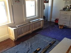bench built over radiators for extra seating. Love it! ~loft & cottage