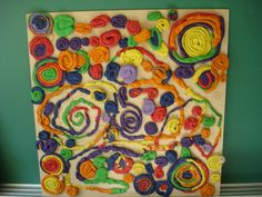 Collabortive Art Piece - each student made a spiral. We read Swirl by Swirl, Spirals in Nature By: Joyce Sidman first. Reggio Inspired.