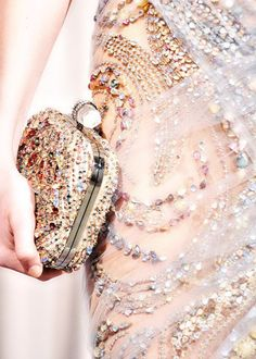 The clutch reminds me of my wedding day clutch. Love the embellishment!