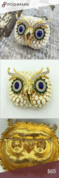 "Kenneth Jay Lane Great Horned Owl brooch Signed Kenneth Jay Lane (KJL) Great Horned Owl brooch,  Book Piece.  Ivory-colored enamel and gold tone brooch by Kenneth Jay Lane Great Horned Owl with rhinestone eyes and horns.    Brooch measures 2""x2""  Book reference ""Shameless-Jewelry from Kenneth Jay Lane"" page 119  Find us on Facebook and Instagram at My Vintage Gems 1950.  www.myvintagegemsraleigh.com Kenneth Jay Lane Jewelry Brooches"