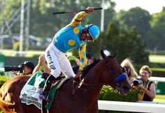 Victor Espinoza reacted after guiding American Pharoah to victory in the Belmont Stakes, capturing the first Triple Crown in 37 years.
