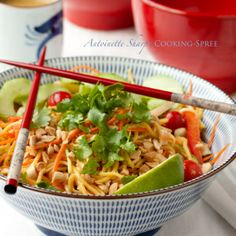 NoodledTangleThaiSalad-2  if you can buy a decent thia peanut dressing then it will save you from having to buy some unique ingredients.  Otherwise it's just Thia noodles, carrot, zuccini, red bell pepper and jimica jullianne cut wih the peanuts and dressing.  Garnish with parsley.