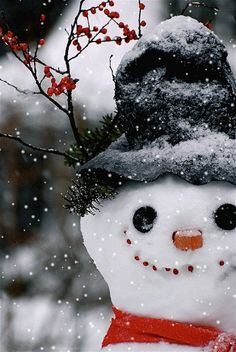 Jolly snowman with falling snow... click on gif
