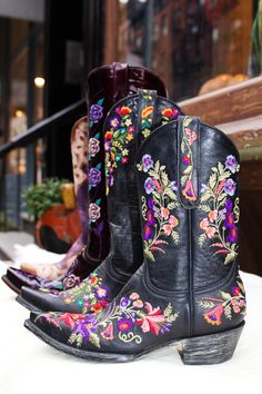 Purple and black cowboy boots at Space Cowboy NYC