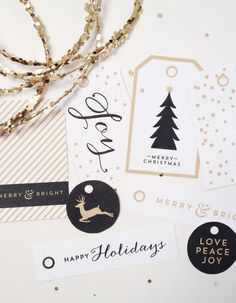 Free printable Christmas gift tags from Creative Index. Available in gold & black and red & green.