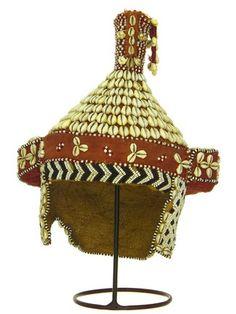 Crown Kuba DATE:1940 - 1960 DIMENSIONS:L 36 cm x 76.5 cm circumference MATERIALS:Wood; raffia; cotton; leather; cowrie shell; glass bead TECHNIQUES:Appliquéd; beaded
