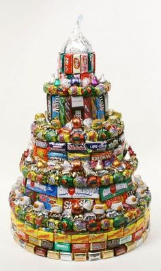 I have been doing a lot of writing about unusual Birthday Cakes lately and then I came across these Candy Cakes. These cakes are just made up of Candy, still in their wrappers, from Top to Bottom. It does not take much to create one of these Candy. Cakes To Make, How To Make Cake, Candy Birthday Cakes, Candy Cakes, Cupcake Cakes, Cupcakes, Birthday Gifts, Happy Birthday, Sweets Cake