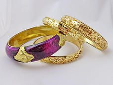 $12.00 - Expensive in look but not in price! This bangle set includes 4 bangles total. Three bangles are gold-tone with gorgeous filigree design. Fourth bangle is variations of purple with gold-tone accents.  #PINKBangles #PINK #Bangles #Bracelets #PINKPixie   #Nonprofit    All of our proceeds go to educating women in crisis. www.pinkpixie.org