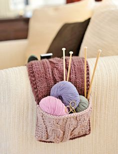 """Treat yourself to this cosy sofa tidy, designed by Debbie Tomkies. """"I can keep my row counter and scissors in one pocket and the TV remote control in the other"""" says Debbie! If you like this, browse all of our Debbie Tomkies patterns, and be sure to check out her website at www.dtcrafts.co.uk."""