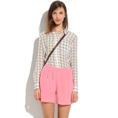 """Madewell Pink Silk Tap Shorts Sold Out These silk shorts are Eden prettier in person. They are such a beautiful bright coral pink color and are pleated. They would fit a 2-4 in my opinion. """"These swingy shorts combine the drapey feel of a skirt and the ease of shorts; it's a win-win in our book."""" •Drapey, easy aesthetic; fixed waistband. •4"""" inseam. •Silk. •Dry clean. •Import. Madewell Shorts"""