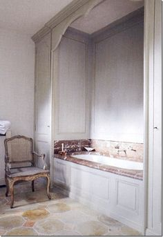 Love the classic French paneling, the marble, the stone floor, the chair, the muted colors. Did I leave anything out?